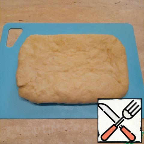 From the resulting test to form a small rectangle. The smoother and more correct it will be, the easier it will be in the future to roll. Wrap in film or parchment and refrigerate, on the bottom shelf for at least 4 hours. Better at night and can be left at 12h. or 24h. I have the dough lay a little less than a day.