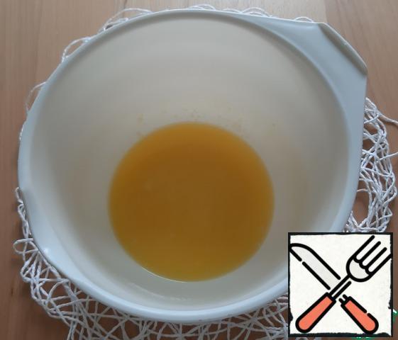 Melt margarine in microwave, add sugar, mix well.