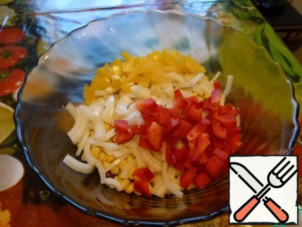 Cut onions and bell peppers.