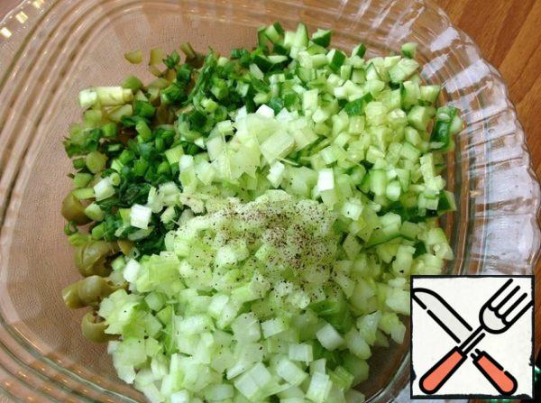 Fresh cucumber cut into small dice, stalks celery, too. Finely chop the green onions. Add the taste of freshly ground black pepper.