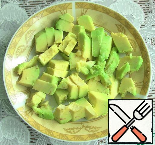 Avocado peel and cut into cubes as well.