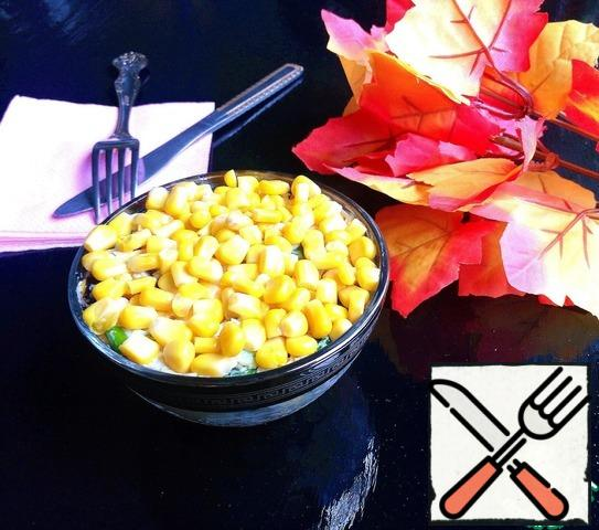 Mix the salad and serve in portions, decorated with corn on top.