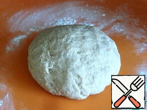 "Knead the dough on the table, you may have to add a little flour, but only a little. Do not ""hammer"" the dough with excess flour, it should be soft and elastic."
