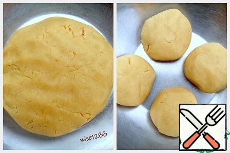 Knead the dough. The finished dough will turn obedient, pleasant consistency. Divide it into 4 parts.