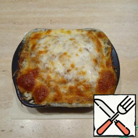 The cheese should melt and brown. Allow the casserole to cool slightly in the form, then completely cool on the grill.