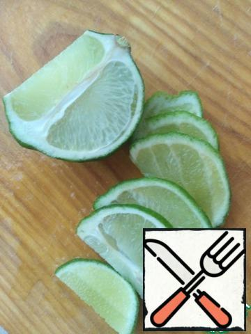 Cut lime in half. One half cut into slices, and from the second half squeeze juice.