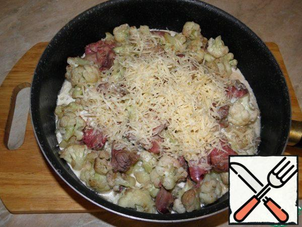 Cheese grate (I like fine) and also add to the dish.