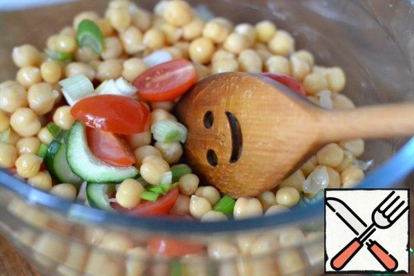 With canned chickpeas, drain the liquid. In a large bowl, mix chickpeas, cooled couscous, tomatoes and cucumber. Salt and pepper to taste.