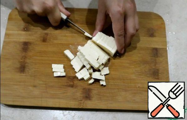 Cut the processed cheese into cubes.