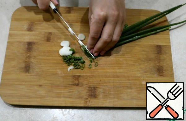 Chop the green onions.