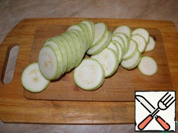 Zucchini cut into circles.