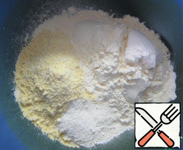 In a bowl combine flour, corn flour, a pinch of salt and baking powder dough. Stir. Add sugar and mix again.