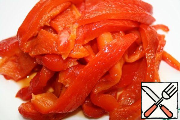 Bake the pepper at a temperature of 200 degrees for about 45 minutes. Remove the skin, remove the seeds and cut into strips.