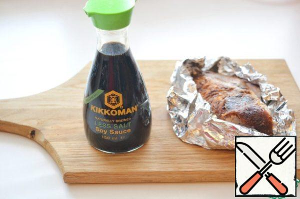 Mix 2 tablespoons soy sauce and 2 tablespoons orange juice, marinate the duck breast in this mixture for half an hour. Wrap it in foil and place in a preheated 200°C oven. Bake for 30 minutes, cool completely in foil, cut into thin slices.