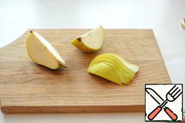 Ripe juicy pear cut into thin slices.