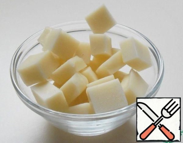 Cheese cut into medium-sized cubes.