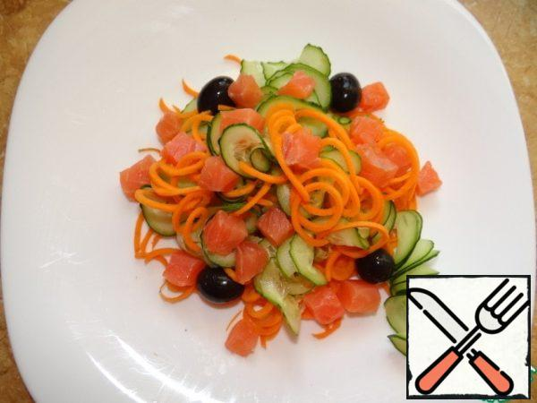 Cut trout into cubes and add to vegetables with olives;