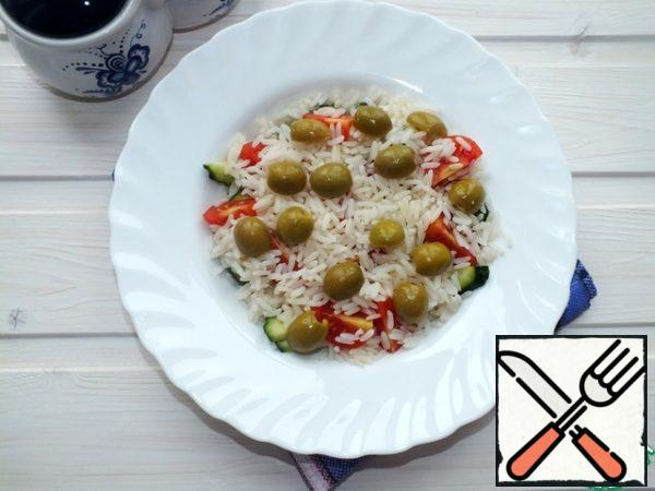 Olives cut into two halves, add the crumbly rice.