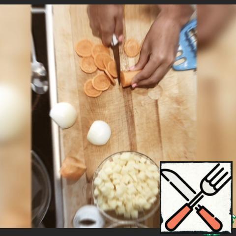 Cut potatoes, carrots, chop onions.