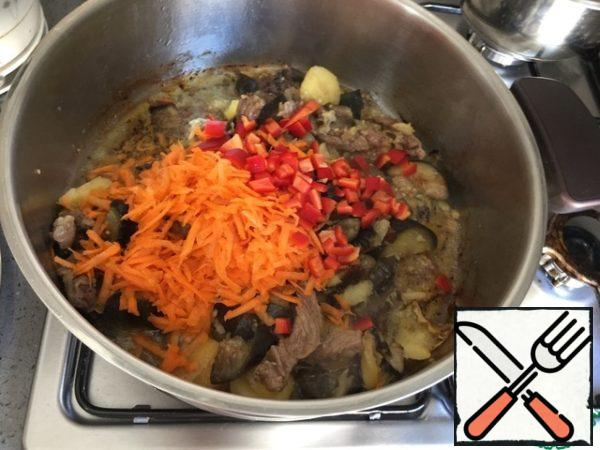 Add carrots, bell peppers, spices to taste. Simmer until all ingredients are ready.