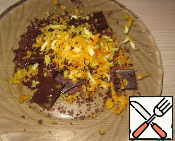 Will break the chocolate, grate the zest from the orange.