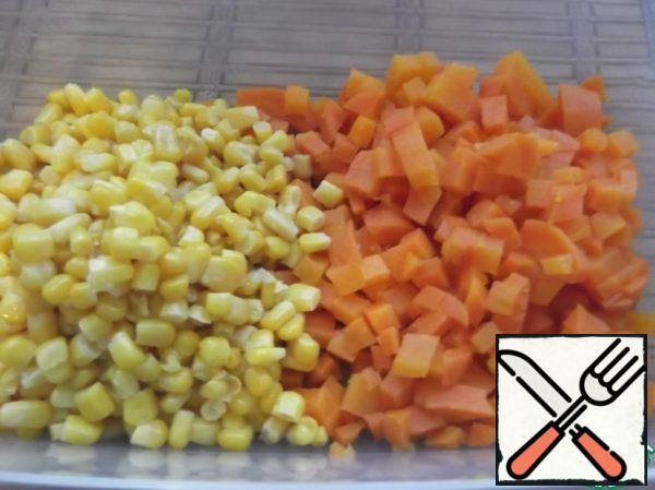 Add corn, cut boiled carrots.