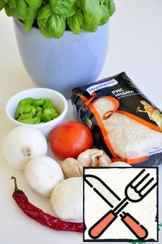 Rice boil in slightly salted water until tender. Peel the beans. Wash, peel and chop the vegetables.