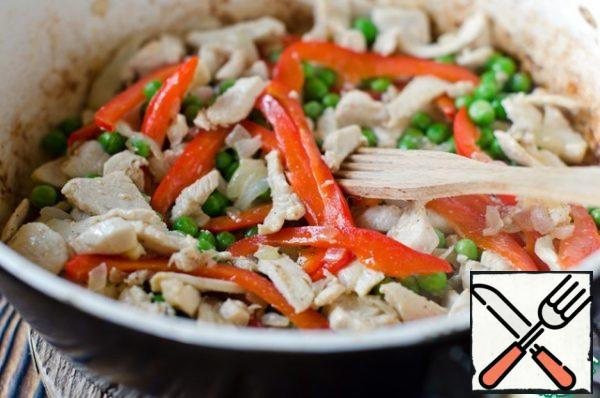 Add the bell peppers and green peas, pepper and cook for 2 minutes.