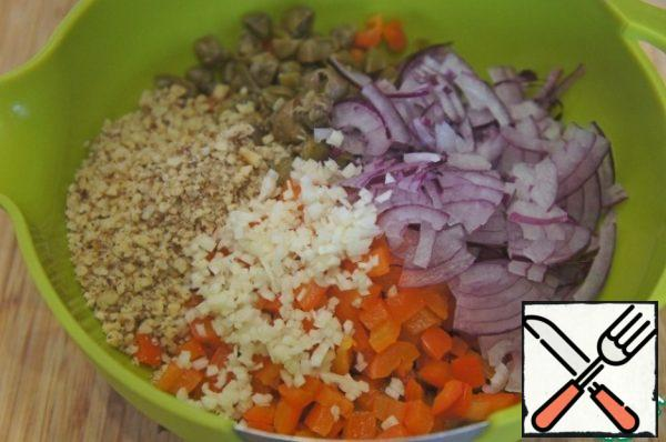 Add capers, onion, garlic and nuts.