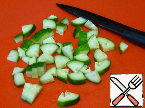Dice the cucumber.