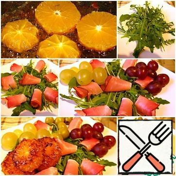 Oranges peel and cut into slices thickness approximately 1 see Each circle, season to taste herbs de Provence. Heat olive oil in a frying pan, carefully put the orange (carefully, the oil can be splashed!) and fry on both sides. Optionally, you can add oranges honey. Wash and dry arugula and grapes, cut Parmesan into thin slices. Put arugula on a dish, lay thin slices of ham on top. Add in salad grapes and olives. Put the fried orange and cheese.