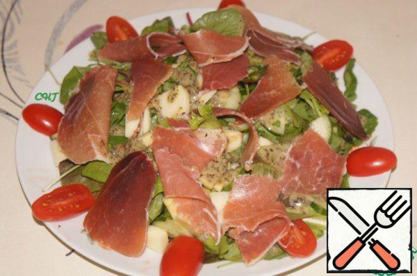 Slices prosciutto is put inside to tear into strips or pieces and put on salad.