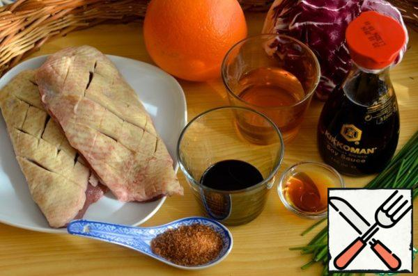 Make incisions on the duck Breasts.
