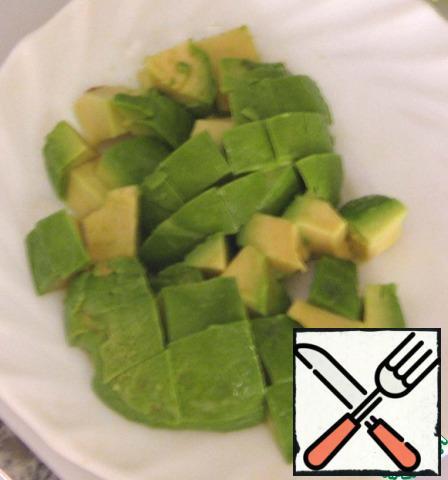 Avocado cut in half, get a bone, pulp cut into cubes.