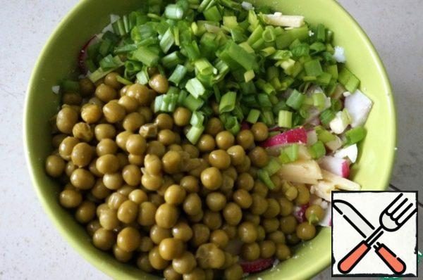 Add the green peas and finely chopped green onions.