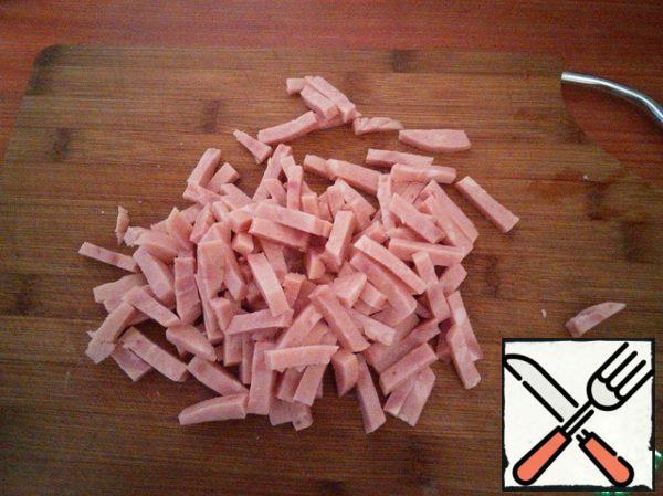 Ham cut into strips.