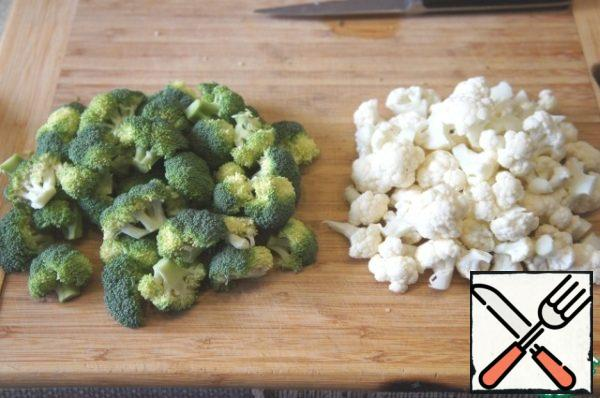 Broccoli and cauliflower divided into small inflorescences.