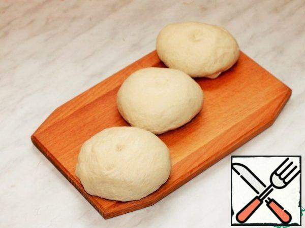 Spread the dough on a cutting Board and divide into 3 parts.