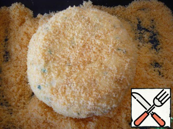 Roll the cheese ball in shredded corn sticks.