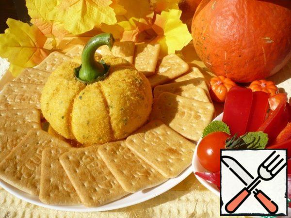 Serve the Pumpkin cheese ball on a plate with crackers and pieces of sweet pepper.Bon appetit!