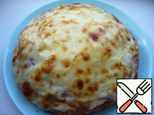 Ready pie spread on a plate.