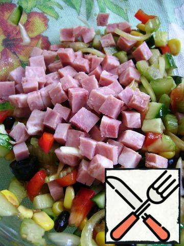 Divide the base in half and add the ham cubes to one half. Stir.