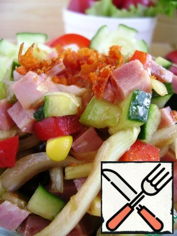 Sprinkle with chili chips and garnish with fresh cucumbers.