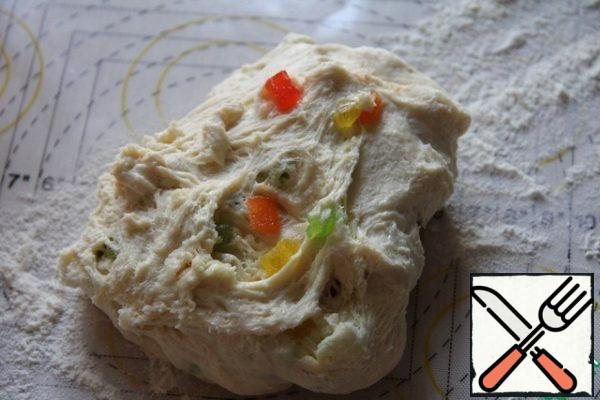 Then add the butter at room temperature and knead for 5 minutes. Last of all, add candied fruits, knead again.
