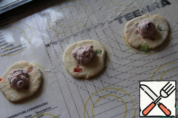 Roll out each ball of dough and lay the filling.