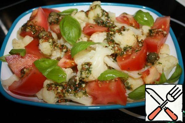 Mix the cabbage and tomatoes with the dressing. Garnish with Basil leaves. Bon appetit!!!