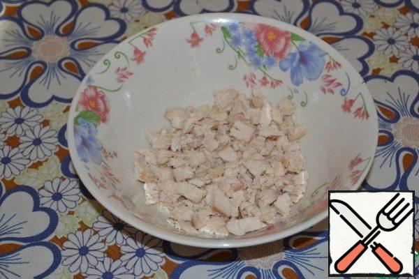 Boil chicken breast in salted water. Cool and cut into small cubes.