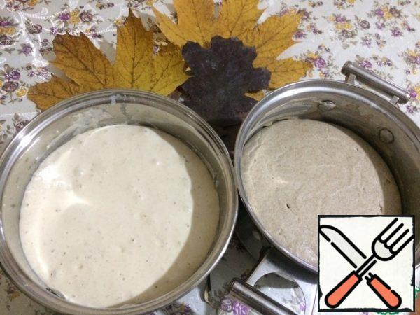 Our sourdough has increased significantly in volume and is ready for kneading bread. Now in two deep bowls sift the WHEAT flour.