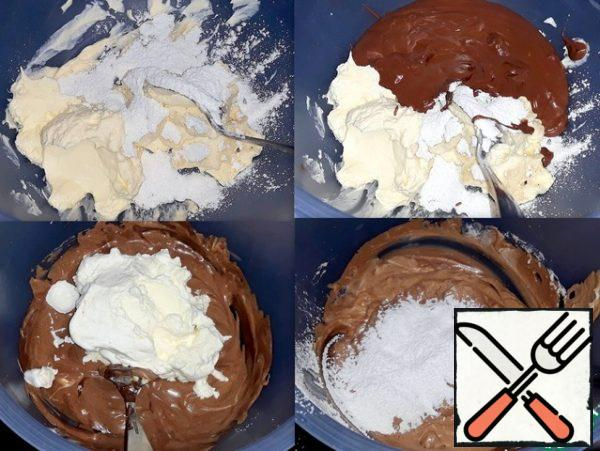 In a bowl put the cheese and vanilla sugar. In the microwave melted chocolate and shifted put it in a bowl. Chocolate lovers can use not 100 g, and 200. Chocolate and cheese mixed. Beat the cream with a thickener and put them in a bowl. In creamy chocolate mass added powdered sugar and stirred the contents well bowls.