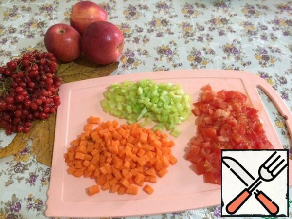 Meanwhile, cut into small cubes carrots, tomatoes, bell peppers.